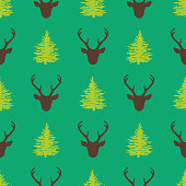 istock Christmas seamless pattern with deer head and fir tree silhouettes 1287669019
