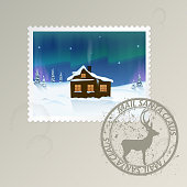 "Christmas set postage stamp with the image of a winter landscape with a hut. a stamp with a deer and the words ""Santa Claus post"". grunge spots"