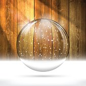 Christmas snow globe on wooden wall.