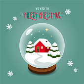 Christmas snow globe with a little red house.