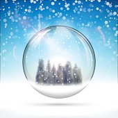 Christmas snow globe with hristmas trees and snow on bright blue background.