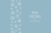 istock Christmas snowflake elements border card with greeting text seamless pattern ice blue background. 1182284852
