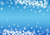 White beautiful snowflakes on gradient blue background
