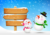 Christmas Snowman and snowgirl and wooden sign blank board and winter snow with copy space vector illustration eps 10