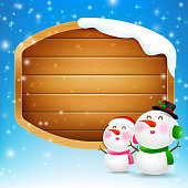Christmas snowman and snowgirl with blank wooden sign vector illustration eps 10