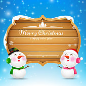 Christmas snowman and snowgirl wooden sign with text merry christmas vector illustration eps 10