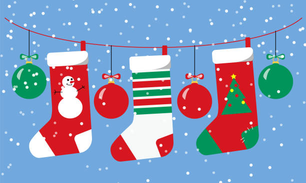 Christmas socks and balls red and green hang on a garland with snow fall.  Horizontal design for New Year cards banners social media template. Stock vector flat illustration. Christmas socks and balls red and green hang on a garland with snow fall.  Horizontal design for New Year and Christmas cards banners social media template. Stock vector flat illustration. christmas stocking stock illustrations