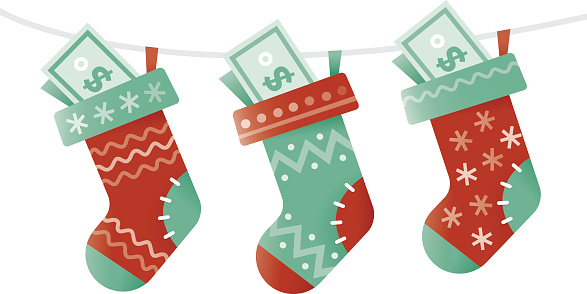 Christmas socks stuffed with money. New successful business year concept.