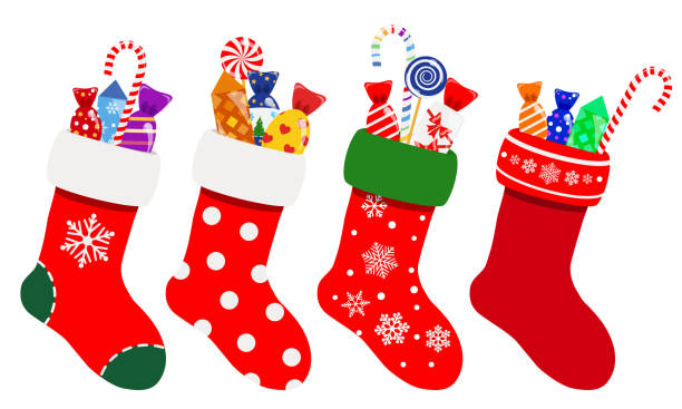 Christmas socks with candies Set of Christmas socks in red colors with candies. Vector illustrations. EPS10 and JPG are available christmas stocking stock illustrations