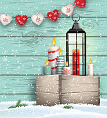 Christmas still-life, wooden box with candles and lantern on blue wooden background, vector illustration, eps 10 with transparency