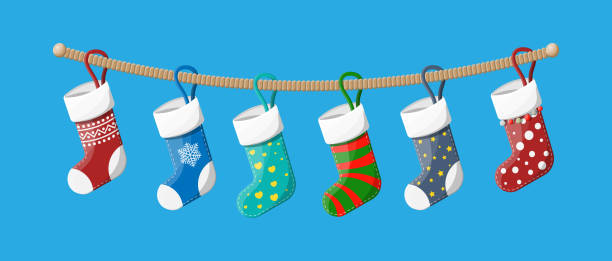 Christmas stockings in various colors on rope Christmas stockings in various colors on rope. Set of christmas cloth socks. Hanging holiday decorations for gifts. New year and xmas celebration. Vector illustration in flat style christmas stocking stock illustrations