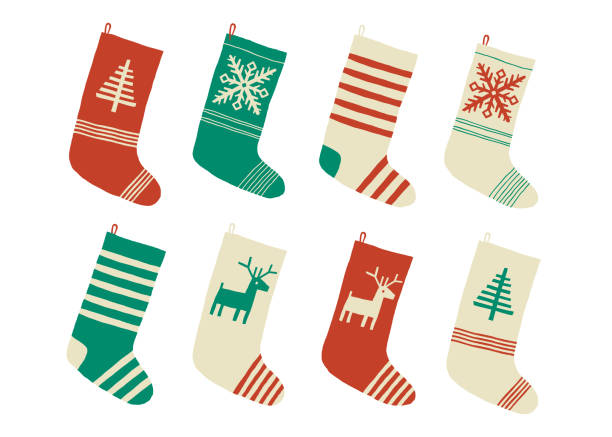 Christmas stockings. Various traditional colorful and ornate holiday stockings or socks collection. Cartoon New Year vector eps 10 illustration isolated on white background in a flat style. Christmas stockings. Various traditional colorful and ornate holiday stockings or socks collection. Cartoon New Year vector eps 10 illustration isolated on white background in a flat style christmas stocking stock illustrations