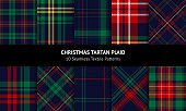 istock Christmas tartan plaid set. Blue, red, green, yellow dark textured decorative check plaid for flannel shirt, blanket, trousers, duvet cover, throw, or other New Year winter fashion textile print. 1256331179