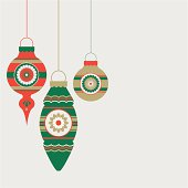 Christmas tree baubles on a silver background.