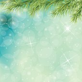 Christmas Tree Branches On Blue Green Pastel Background with Sparkling Lights and bokeh.