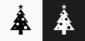 Christmas Tree Icon on Black and White Vector Backgrounds. This vector illustration includes two variations of the icon one in black on a light background on the left and another version in white on a dark background positioned on the right. The vector icon is simple yet elegant and can be used in a variety of ways including website or mobile application icon. This royalty free image is 100% vector based and all design elements can be scaled to any size.