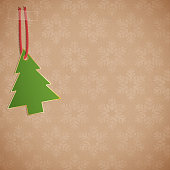 Christmas tree ornament taped to a snowflake background. EPS10 vector illustration, global colors, easy to modify.