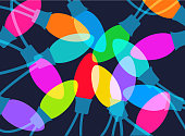 Colourful overlapping silhouettes of Christmas tree lights