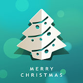 Celebrate Christmas with paper craft of folded Christmas tree on the green background
