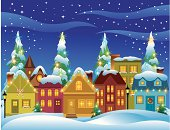 Village of houses and buildings, trees, and lights in a Christmas theme.