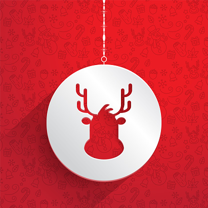 Christmas white hanging decorative tag with a reindeer design over a red background