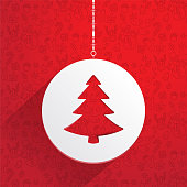 Christmas white hanging decorative tag with a tree design over a red background
