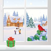 Vector illustration of a Christmas window view with snowy houses and kids making a snowman.