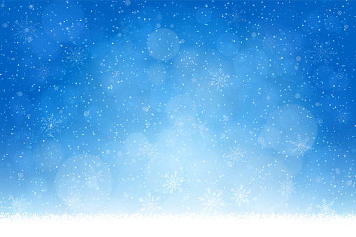 Christmas - Winter blue background: Falling snow, snowflakes and defocused lights