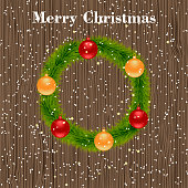 Christmas wreath on a wooden background. Christmas decoration on wooden background. Christmas design