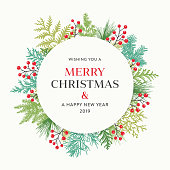 Holiday, Christmas wreath with greetings, evergreen branches and berries.