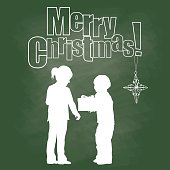 A chalk outline vector silhouette illustration of a young boy giving a gift to a young girl.  The text above reads Merry Christmas with an ornament hanging off the exclaimation mark.