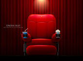 Cinema seat.Theater seat on curtain with spotlight background