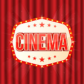 Cinema sign on red curtain. Retro light frame with glowing lamps