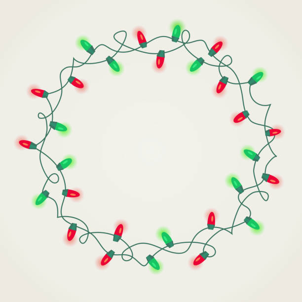 circle frame of green and red christmas lights on white background. - oświetlenie bożonarodzeniowe stock illustrations