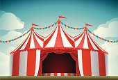 A retro circus tent with clouds in the background.