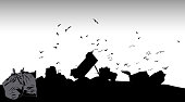 A vector silhouette illustration of a garbage landfill with commercial trucks dumping of garbage with birds flying overhead.
