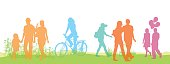 A vector silhouette illustration of different lifestyles in bright colours outside on green grass.  A mother and father walk with their young daughter, a young woman rides her bicycle, another woman walks alone, a young couple walks embracing, and another man and woman walk carrying balloons.