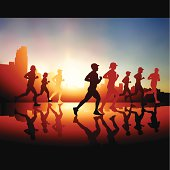 Silhouetted runners against an urban skyline with the sun rising behind them.
