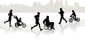 Different types of people get exercise on a shared walkway.