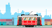 Cityscape with a retro tram passing by. Vector illustration.