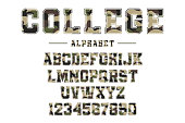 Classic college font with camouflage texture. Vintage sport font in american style for football, baseball or basketball t-shirt, varsity style font
