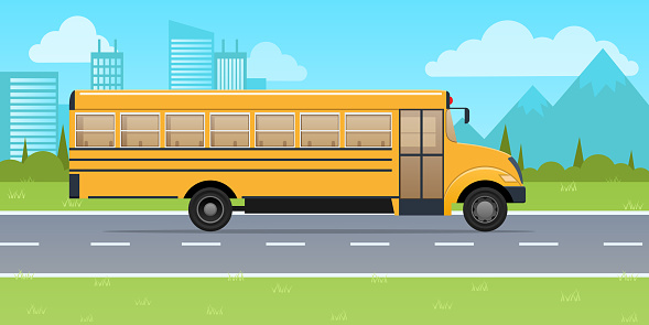 Classic yellow school bus, on background of urban high-rise buildings.