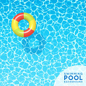Clear blue swimming pool water background for spring break, travel and summer designs.