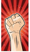 Vector illustration of a clenched fist as a communism styled poster.Objects are on separate layers.
