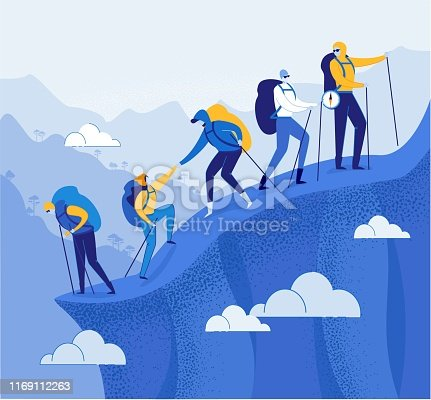 istock Climbers Group Helping each other in Mountains. 1169112263