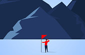 Climbing, businessman holding flag ready to climb the peak