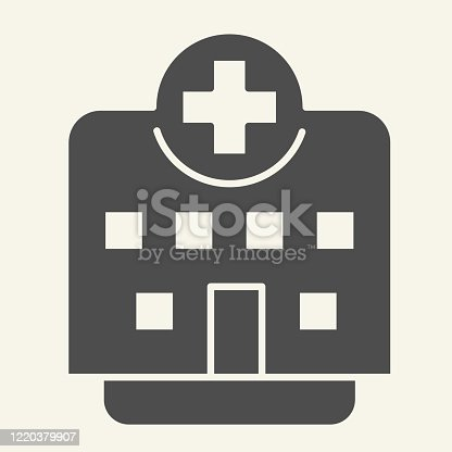 istock Clinic solid icon. Hospital building glyph style pictogram on white background. Medical institution with cross on top for mobile concept and web design. Vector graphics. 1220379907