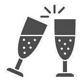 istock Clinking of champagne glasses solid icon, New Year concept, sparkling champagne glasses sign on white background, clink wineglasses icon in glyph style for mobile and web. Vector graphics. 1284653042