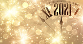 Clock hands showing few minutes to 2021 year.
