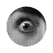 Close up of female eye. Halftone dot pattern.